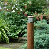 NIMBUS round teak garden bollard light with louvres provides deck lighting or lighting for paths or terraces from a natural looking product